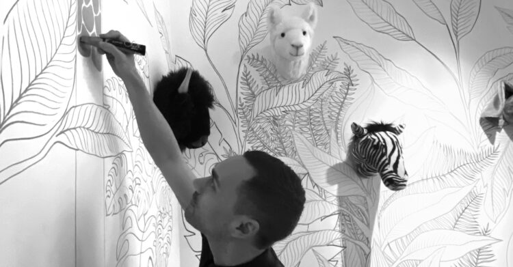 Joey Holthaus drawing mural art